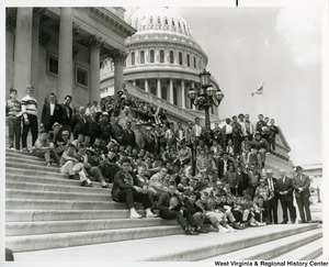 Congressman Arch A. Moore, Jr. on the steps of the Capitol with an unidentified boys patrol group.
