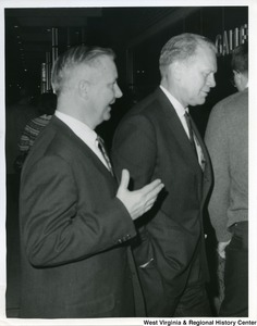 Congressman Arch A. Moore, Jr. walking with and talking to Gerald Ford, who at this time was a Michigan Congressman.