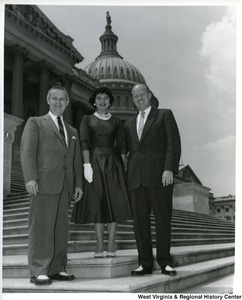 Congressman Arch A. Moore, Jr. (left) with an unidentified woman and man on the steps of the Capitol Building.