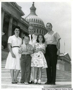 Congressman Arch A. Moore, Jr. on the steps of the Capitol Building with an unidentified family of four.