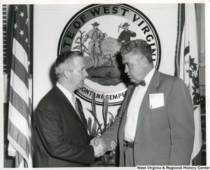 Congressman Arch A. Moore, Jr. shaking hands with David T. Frew, Mayor of Weirton, W.Va. (1959-63).