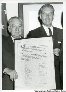 "Congressman Charles A. Halleck (R-IN, left) receiving an award for his wise and friendly counsel. Halleck served as the Republican leader of the House of Representatives. The award states:""We the undersigned, do hereby express our admiration and our deep gratitude to Charles A. Halleck, for his wise and friendly counsel.  Each of us is indebted to his generous assistance, inspiring leadership and personal interest in our activities, political and in the field of legislation.His  unflagging efforts and his readiness to assist us with his time and his great store of knowledge, judgement and wisdom are greatly appreciated. He has benefited us as new Congressman, and the Nation, by making more effective our beginning years in congress."""