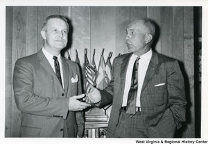 Congressman Arch A. Moore, Jr. shaking hands with West Virginia state Senator Theodore Bowers.