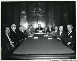 A group of congressmen sitting at a table. From left to right: (?), Congressman Tom Steed, Congressman Sidney Yates, Congressman Abraham Multer, Congressman Joe Evins, (?) , Congressman J. Lister Hill, (?), Congressman William M. McCulloch, and Congressman Arch A. Moore, Jr.