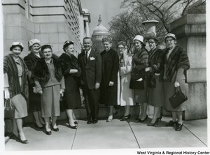Congressman Arch A. Moore, Jr. (center) with an unidentified group of women. The Capitol Building can be seen in the background.