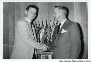 Congressman Arch A. Moore, Jr. shaking hands with Bob Chustman.