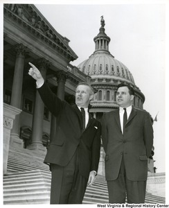 Congressman Arch A. Moore, Jr. pointing out something to Mr. Finbill. They are standing on the steps of the Capitol Building.