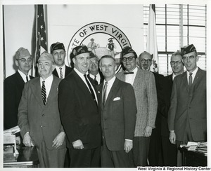 Congressman Arch A. Moore, Jr. (center) with unidentified Veterans of Foreign Wars.