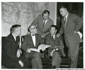 Congressman Arch A. Moore, Jr. going over a document with Congressman William McCulloch (R -OH), Congressman Joe Evins (D - TN) and two other congressmen.