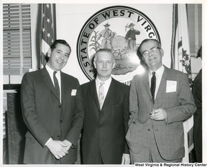 Congressman Arch A. Moore, Jr. (center) with Albert Robinson (right), City Commission of Fairmont, and an unidentified man.