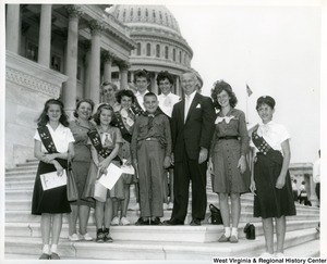 Congressman Arch A. Moore, Jr. was visited by Girl Scout Troop Number 34 of Weirton, W.Va. The Girl Scouts were accompanied by Mrs. Paul Doboski of Weirton, Scout Leader, her son, Paul Doboski, and Mrs. Andrew Jezierski, also of Weirton. Congressman Moore enjoyed the company of these ladies as the guests at luncheon in the United States Capitol. The members of Troop #34 pictured are Jeanette Oliver, Barbara Kelly, Rita Rurak, Patricia Jezierski, Kelli Sue Pyles, Barbara Pyles, and Stephanie Visnic.