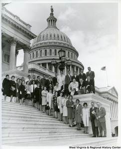 Twenty-five students from Bethany College, accompanied by J.G. Patterson, Director of the Falk Foundation Studies at the College, with Congressman Arch A. Moore, Jr. on the steps of the Captiol. The students were in Washington on their annual D.C. field trip.