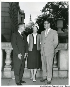 Congressman Arch A. Moore, Jr. with Mr. and Mrs. Donald H. Smith, two Glen Dale residents, who were in the nation's capital to attend the annual meeting of the President's Committee on Employment of the Physically Handicapped.
