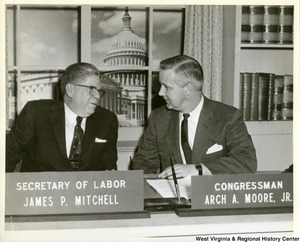 Congressman Arch A. Moore, Jr.  with Labor Secretary James P. Mitchell in the House Recording Studios in Washington. Mitchell will be the Congressman's guest on his weekly radio program which will be released to stations throughout the First Congressional District. Moore is conferring with Mitchell in regard to new legislation recommended by the President to extend unemployment benefits an additional 13 weeks. Moore indicated he would support the bill and urged early enactment by Congress. The Labor Secretary expressed optimism as to an early upturn in business and more jobs to ease the economic slump.