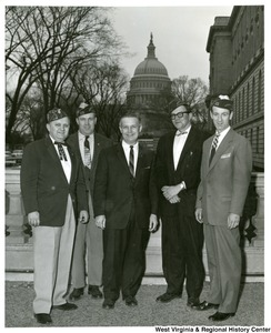 Members of the Department of West Virginia Veterans of Foreign Wars were in Washington to attend the National VFW Convention. The vet leaders took time to be luncheon guest of Congressman Arch A. Moore, Jr. and to visit Capitol Hill. Standing on the steps of the House Office Building with Congressman Moore (center) are John J. Berger of Moundsville, David J. Lowery of Wierton, Don S. Maupin of Moundsville, and George J. Reilly of McMechen.