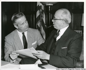 Congressman Arch A. Moore, Jr. having a discussion with Secretary of Commerce Lewis L. Strauss. Strauss was acting secretary for President Eisenhower from November 13, 1958  June 30, 1959.