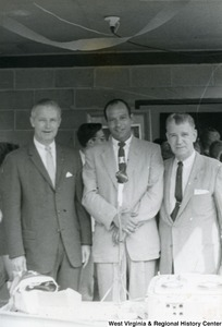 Congressman Arch A. Moore, Jr. standing with two unidentified men at the Ida May dedication.