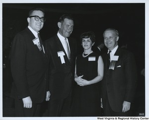 Congressman Arch A. Moore, Jr. with three unidentified people at the Public Affairs Conference.