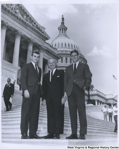 Congressman Arch A. Moore, Jr. (center) on the steps of the Capitol with two unidentified men.