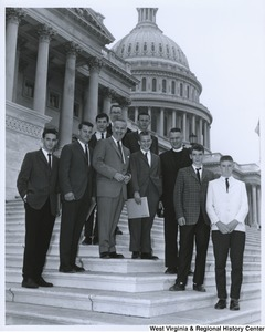Congressman Arch A. Moore, Jr. with a unidentified group of young men on the steps of the Capitol Building.