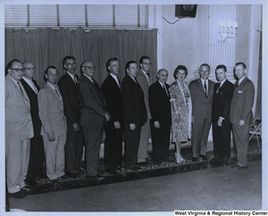 Congressman Arch A. Moore, Jr. (third from the right) with an unidentified group of men and one woman.
