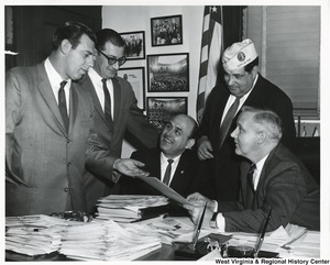 Congressman Arch A. Moore, Jr. discussing disabled veterans with four others, one of whom is James Nocerrt.