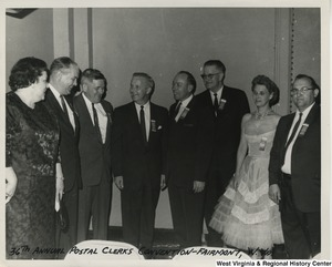 Congressman Arch A. Moore, Jr. at the 26th annual postal clerks convention in Fairmont, W.Va. Moore (center) is seen with seven unidentified men and women.