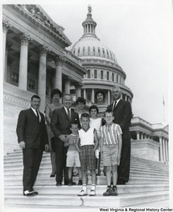 Congressman Arch A. Moore, Jr. with a family on the steps of the Capitol.