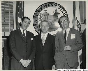 Congressman Arch A. Moore, Jr. (center) standing with Albert Robinson, City Commissioner of Fairmont, and an unidentified man.
