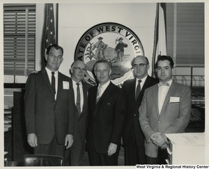 Congressman Arch A. Moore, Jr. (center) standing with four unidentified men.