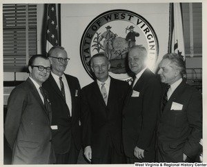 Congressman Arch A. Moore, Jr. with John Gast and Charles Ihlenfeld and two unidentified others in Moore's office. From right to left: Charles Ihlenfeld, Vice Mayor of Wheeling, W.Va.; John J. Gast, Mayor of Wheeling, W.Va.; Congressman Arch A. Moore, Jr.; unidentified, unidentified