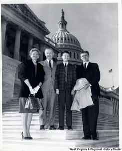 Congressman Arch A. Moore, Jr. standing on the steps of the Capitol with three unidentified people.