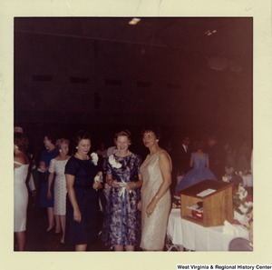 Three unidentified women at a party.