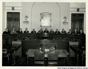 Congressman Arch A. Moore, Jr. with other congressmen in a hearing room. From left to right: Dale Alford, unknown, Tom Steed, unknown, Abraham Multer, Joe L. Evins, Emanuel Celler, William M. McCulloch, Arch A. Moore, Jr., unknown, H. Allen Smith, William Cahill, and unknown.