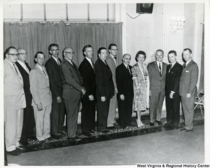 Congressman Arch A. Moore, Jr. standing with a group of unidentified men and one woman.