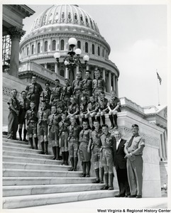 Congressman Arch A. Moore, Jr. standing with a Boy Scout Troop on the steps of the Capitol.