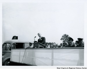 Congressman Arch A. Moore, Jr. speaking at a podium at the 9227th Air Force Reserve dedication in Clarksburg, W.Va.