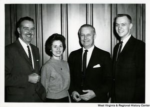 Congressman Arch A. Moore, Jr. standing with two unidentified men and one woman.
