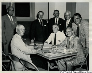 Congressman Arch A. Moore, Jr. with seven unidentified men. Moore is standing fourth from the right.