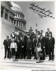 "Congressman Arch A. Moore, Jr. standing on the steps of the Capitol Building with an unidentified group of West Virginia Veterans of Foreign Wars.  The photograph is signed ""Best wishes from Arch A. Moore, Jr. """