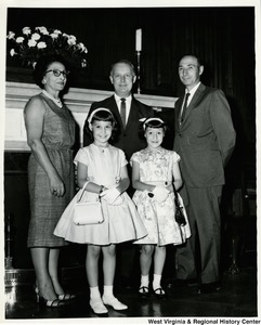 Congressman Arch A. Moore, Jr. standing with an unidentified family of four.