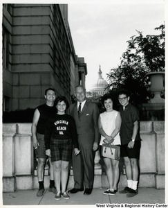 Congressman Arch A. Moore, Jr. with an unidentified group of four. The Capitol can be seen in the background.