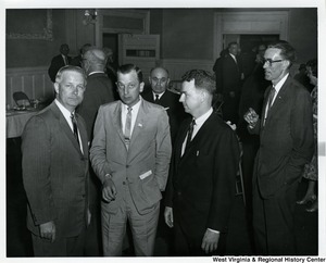 Congressman Arch A. Moore, Jr. with three unidentified men at a party.