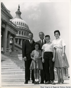 Congressman Arch A. Moore, Jr. with an unidentified family of four on the steps of the Capitol.