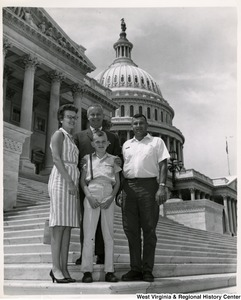 Congressman Arch A. Moore, Jr. with an unidentified family of three.