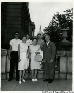 Congressman Arch A. Moore, Jr. standing with an unidentified family five.