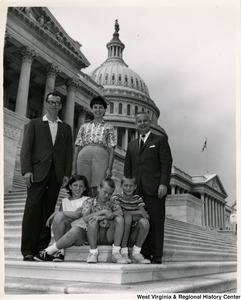 Congressman Arch A. Moore, Jr. with an unidentified family of five on the steps of the Capitol.