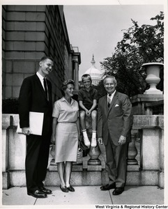 Congressman Arch A. Moore, Jr. standing with an unidentified family of three.