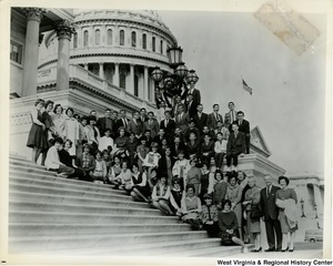 Congressman Arch A. Moore, Jr. and his wife on the steps of the Capitol Building with a large unidentified group of young men and women.