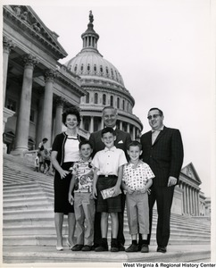 Congressman Arch A. Moore, Jr. (center) standing on the steps of the Capitol Building with the Rodriguez family of Moundsville. From left to right are Helen Marie, Brian, Benny, Bruce, and Benny Rodriguez.